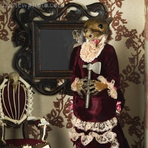 Yes, this is a taxidermy diorama of Lizzie Borden with her ax. Of course, the real Lizzie was acquitted for killing her dad and stepmom and it's not known whether she did. Still, if she did it, whack count was at 11 for her stepmom and 19 for her dad. Not only that, but if guilty, she probably killed them over a family dispute.