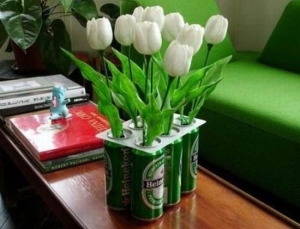 I'm sure this Heineken six pack tulip planter will only please two kinds of people: rednecks and environmentalists. Other than that, most people would question your taste in interior decorating upon viewing this.