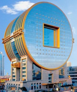 Whether a giant microchip, subway token, power generator, or whatever the hell it is, this building seems to be China's burgeoning capitalism, innovation, and a bad taste for architecture.