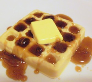 Yes, this is waffle soap. And no, I'm not sure if it tastes like maple syrup. That, or whether the maple syrup on that is actually solid soap.
