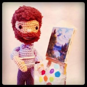 Still, while I know it's Bob Ross, I kind of wish the person making this gave him more of an afro like he had in real life. Still, he did paint those lovely paintings like that on his show.