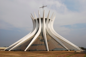 This is Brazil's Metropolitana de Nossa Senhora Aparecida in Brasilia as well as the seat for its local Catholic Archdiocese. It was built in the 1970s and certainly looks like it.  The interior is a combination of a church atmosphere and almost being devoured by a giant squid.