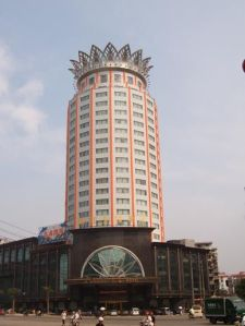 "This is the Nanchang ""Crown"" Building in China. This is supposed to be a luxury hotel. Still, I don't get why it has to look like some large Faberge pineapple. This design would've been more appropriate for the Dole Corporate headquarters."