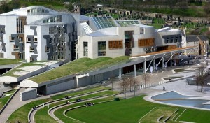 On second thought, you might not want to bring your guns to this building. In fact, it's not the NRA headquarters in Fairfax, VA but the Scottish Parliament building in Edinburgh. Yes, it's incredibly atrocious. Still, what do you mean those gun things aren't guns?