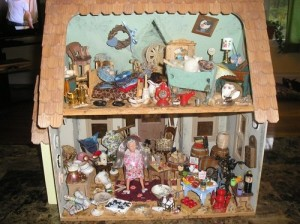 This woman really needs to clean her house. And I suppose that she has a ton of cats as well. Still, this is a doll house you'd give to a young girl.