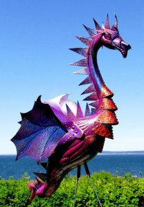 Never in the history of the world has something been so tacky yet so awesome at the same time. Yet, it kind more or less resembles a flamingo cyborg dragon that's painted purple and sprinkled with glitter.