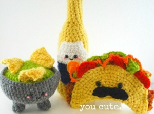 I love the little Mexican mustache on the taco figure. Oh, and I suppose that's a bottle of tequila behind that and the nachos in guacamole.