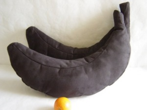 I'm sure the person who made these was planning on doing banana pillows but couldn't find any yellow fabric. So he or she probably settled with black instead. Still, rather disgusting if you know what I mean.