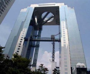 Wait a minute. Despite it's rather sleek utilitarian appearance and unfinished look, this is the Umeda Sky Building from Osaka, Japan. Of course, it's a really big eyesore on its skyline.