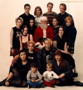 "Santa Claus: ""Great, now I have to pose in this photo with these metal fan kids and their kids. I need a vacation."" Love Santa's expression in this."