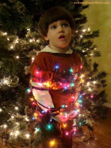 I don't know why anyone would want to tie their kid up in Christmas lights for a photo. That's really messed up.
