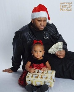 In all fairness, this seems to be the kind of Christmas card you'd see from The Wire. Seriously, the man with the money seems to reflect a lot of negative African American stereotypes if you know what I mean.
