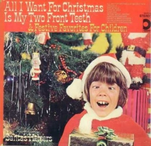 At least if this kid had some form of corrective vision surgery, he might be significantly less creepy than he seems in this album cover. Seriously, what were they thinking?