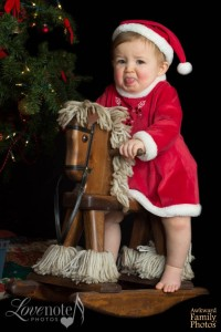 """Okay, so after you're done taking pictures of me on the rocking horse, can we be done here? Also, I just pooped in my diaper."""