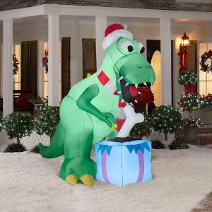 I understand that dinosaurs are cool kid appeal animals, but still, they haven't roamed the Earth in 65 million years. To have a dinosaur in Christmas regalia is about as anachronistic as The Flintstones Holiday Special.