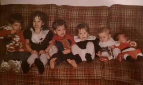 Here's a picture of me with my sister and cousins at my grandparents' house during Christmas of 1994. Here I am pictured between my cousins Frank and John while my sister Molly is seated near my cousins Kerry Ann and Josh.