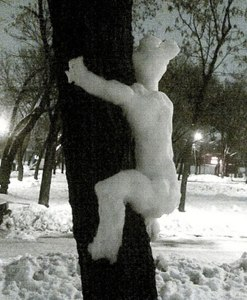 My question on this piece is this: How in the hell did a person manage to make a snowman climbing a tree? It's insane!