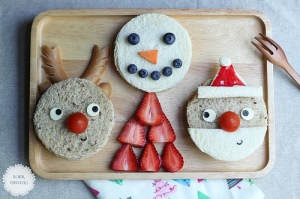 Of course, while Santa and Rudolph's noses are from cherry tomatoes, Frosty's eyes and mouth are made from blueberries and his body is made from strawberries. Santa might also have a strawberry hat while Rudolph has kielbasa antlers.