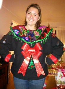 I'm sure this woman took a lot of time to make this sweater as she stands as if she's proud of what she accomplished. Still, I love the wreath though.