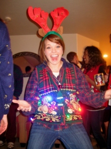 Now this girl looks very excited rocking in her lit up Christmas sweater vest. I also wonder what's in that cup she's holding. Still, I wouldn't be caught dead acting like that at my Aunt Mary's place on Christmas Eve.