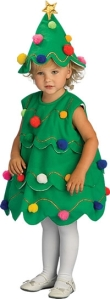"Of course, this little angel is thinking, ""why did mommy and daddy have me dress in this stupid tree costume? Everyone at Grandma's house is going to laugh at me."""