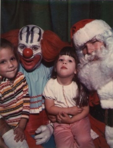 Seems like Santa doesn't enjoy sharing the spotlight this Christmas season,especially with a clown that is more suitable for Halloween nightmares. Still, I'm sure the clown is going to get it once he and Santa get off from work.