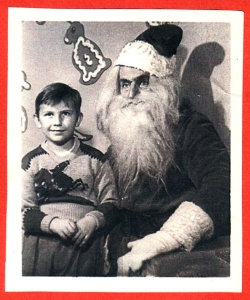 Of course, I'm sure that while the kid seems perfectly composed, Santa seems to be a bit pissed. Then again, imagine if you had to deal with reindeer pooping on people's roofs.