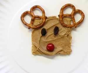 Cute to add the pretzel antlers, the raisin eyes, and the red cherry tomato nose. Still, the kids would love this.