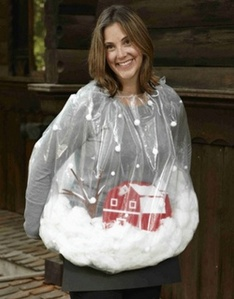 Yet, this woman seems to deck her outfit with a winter scene enclosed in a plastic bag with some cutouts for a barn and tree as well as lots and lots of cotton.