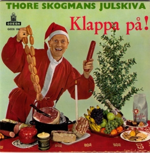 This guy seems very enthusiastic about his Christmas sausage. Seems like he's a bit of a gourmand himself. Still, hope he's not from the Eastern Bloc since I wouldn't know how he obtained that fruit.