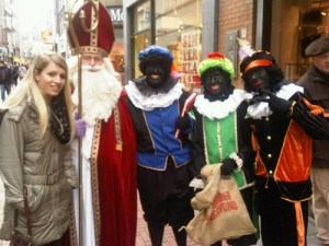 For those not familiar with David Sedaris, this picture was taken in the Netherlands. While we all seem to recognize Saint Nicholas as the bearded white guy, those three guys in blackface are 3 of the 6 to 8 black men. Of course, this is the main reason why I wouldn't recommend black people to travel to the Netherlands at this time in December.