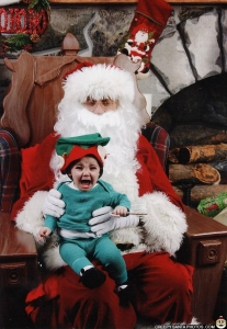Let's just hope that if this is a good kid because I would be terrified if I find out that she's a horrible little elf. Still, I could see evil in this Santa's eyes.