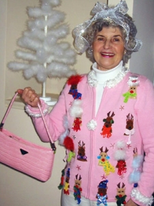 This Grandma is about as chic in her reindeer pink sweater as that aluminum Christmas tree in the background. Yeah, I'm sure she really stands out.