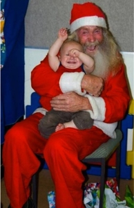 And from how that baby's acting up, I'm sure this Santa certainly smells like a homeless guy. But at least this Santa didn't have to grow a beard.