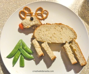 Now this is quite clever with the strawberry nose, the pretzel ears, and the pea pod evergreen tree. Yet, I don't think kids should take this kind of lunch to school. Might ruin the effect.