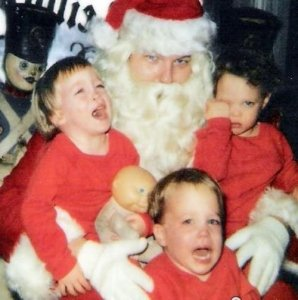Sometimes, it's Santa visits like this that will forever live in these children's nightmares. Still, this Santa seems like he wants to do very naughty things to these innocent souls in his workshop.