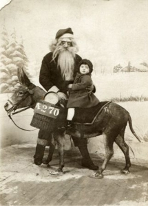 "From Neatorama: ""Again, this vintage Santa picture is simply terrifying and the bearded man looks more like a monster than St. Nicholas. Even the taxidermied donkey looks more alive than this Santa Claus."" Hope this little girl survives her visit to Santa and lives to tell the tale."