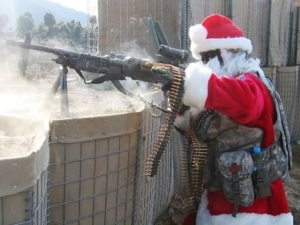 Granted, he's most likely an American soldier playing Santa during his tour of duty who's recently besieged by combat. But still, this is pretty damn funny.