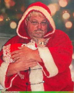 Now this Santa seems so terrifying that even the cat is freaking out. Still, I bet Santa is going to have a lot of scratch marks once this photo op is over.