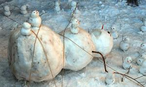 I suppose this snowman feels trapped under the ropes of the smaller ones who tied him up. Still, pretty clever.