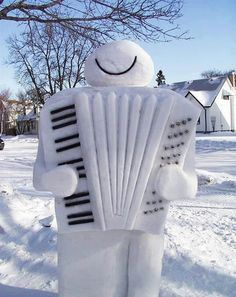 Of course, the accordion is almost lifelike and the snowman is sure happy. Still, I don't why it doesn't have a pair of eyes or a nose.