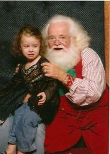 I don't like the look on that Santa's face and neither does the girl on his lap. In fact, she wishes she wouldn't want to sit on Santa's lap anymore.