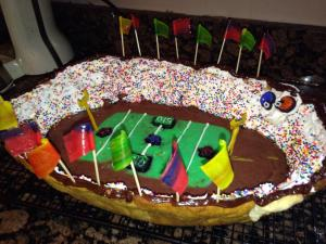 With cookie crusts, icing stands with sprinkles, fruit roll-up flags, and pudding turf, I'll take it. Now I'm sure those sprinkles had very expensive seats because Super Bowl tickets aren't cheap.