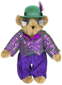 Yes, this is a Teddy Bear of Elton John perhaps from his fame in the 1970s. Love his star sunglasses and shiny purple jacket. Now that's simply adorable.