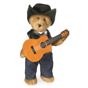 I originally thought that this was a Johnny Cash Teddy bear. Then again, if it was, then he'd be dressed in black. Also, has a female counterpart named Paisley.