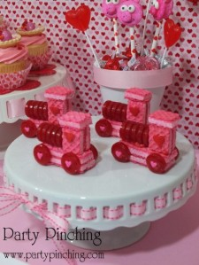 Now these sweet candy/cookie trains are adorable and would make wonderful treats for a child's school V-Day bash. Man, what you can do with pink cookies and life savers.