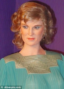 I don't know about you but I think this wax statue makes it seem that Princess Diana was a real stuck up bitch during her lifetime. I mean she has such an ugly scowl on her face as if her secretary won't take her coat off and put it on the mud puddle so she can walk over it without damaging her Prada shoes.