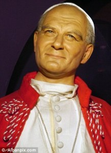 Seems like the Roman sunshine doesn't do any wonders for the already leathery skin on this Polish pontiff. Also, he kind of seems pretty terrifying to me.