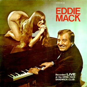 "Seriously, how could they get away with this in the 1960s? Still, seems that Eddie Mack has that stupid grin on his face as if he's saying, ""fanservice, simply fanservice."" Nevertheless, she's probably there to give him a lap dance."