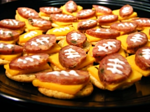 Now these have pepperoni shaped footballs, cheddar cheese, and Ritz crackers. Of course, I don't know what the white stuff is on the pepperoni. Probably cheese.